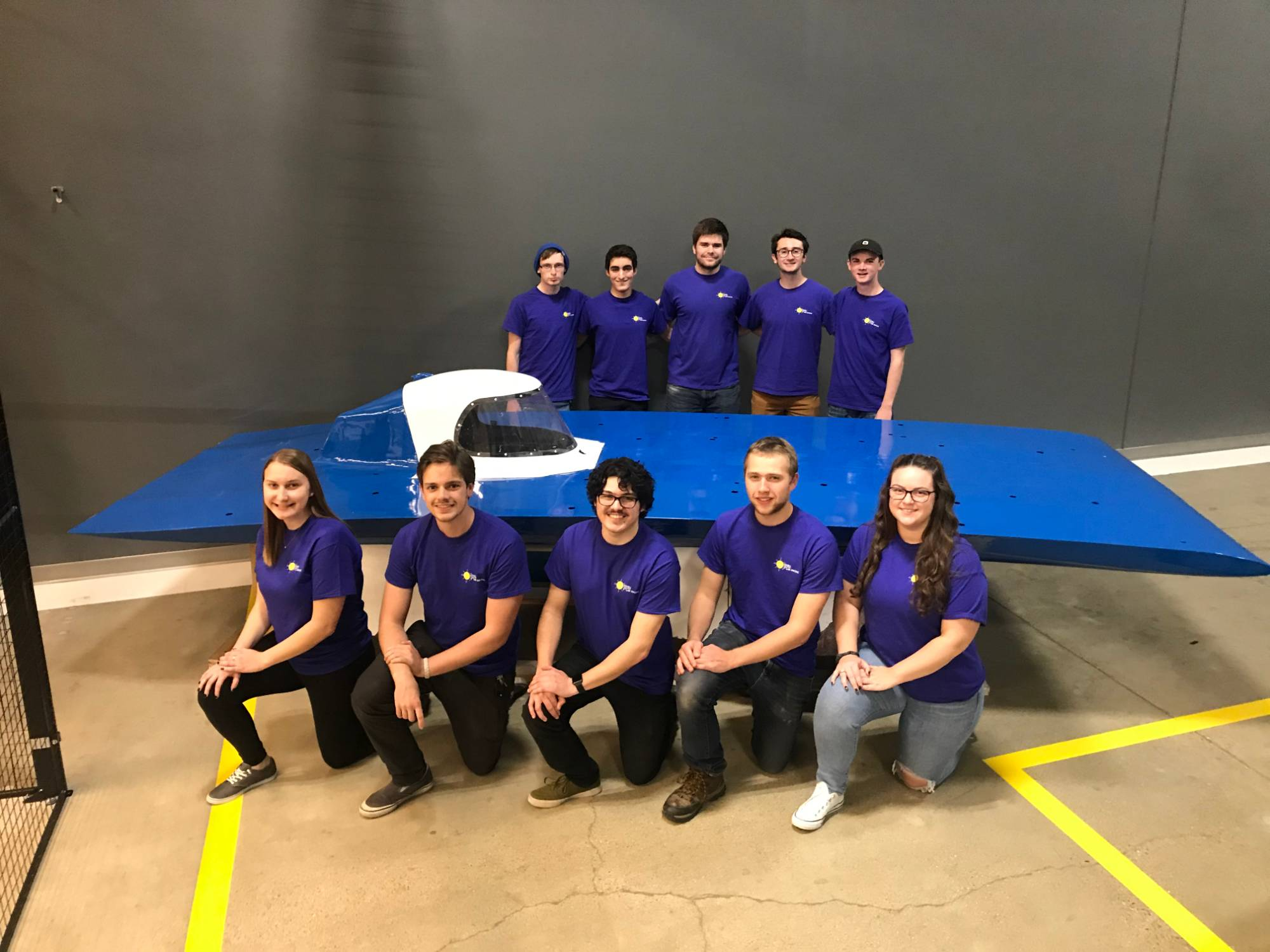 Students in front of the solar racing vehicle